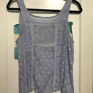 Light blue with white daisies top. Lightly worn.